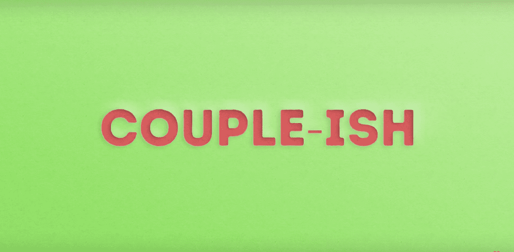 pink couple-ish logo on a green background