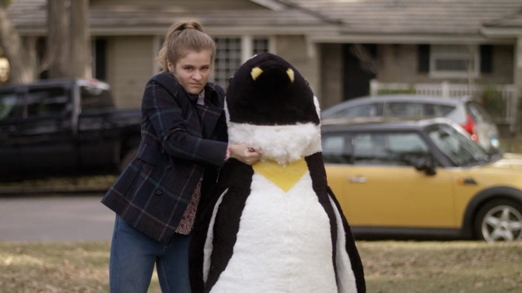 Jenna Boyd as Paige Hardaway in Netflix's Atypical, destroying a giant stuffed penguin