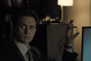 Tyrell holds up a key in Elliot's hallucinatory vision