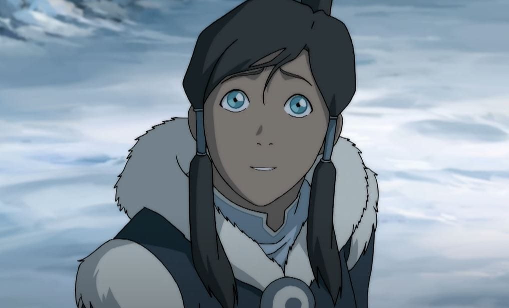 Hopeful Korra, smiling slightly, looking up while in her Water Tribe outfit