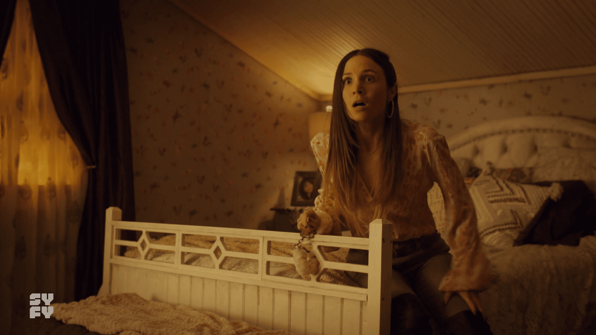 Waverly handcuffed to the bed, in a not fun way.