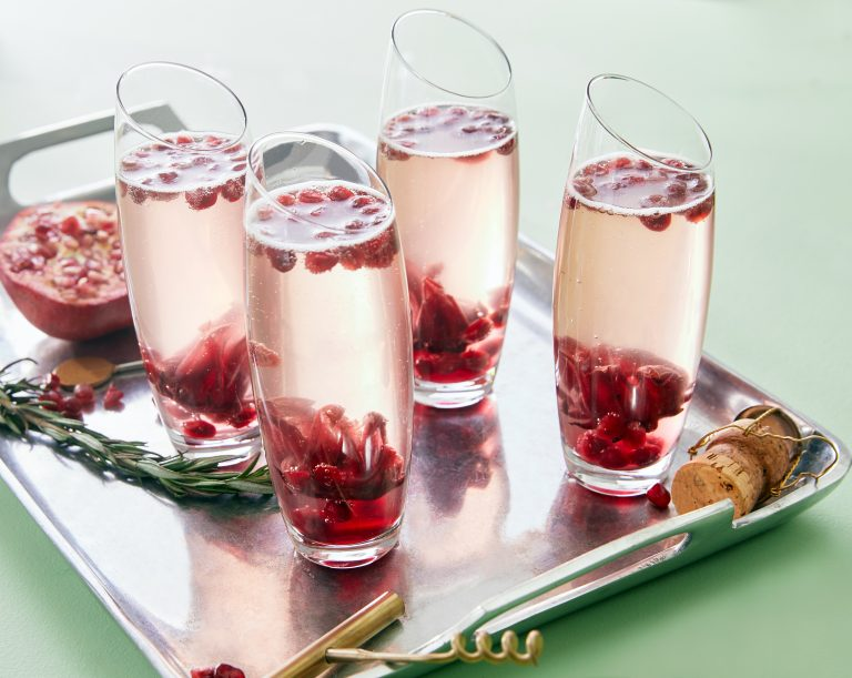 champagne flutes with pomegranate drink