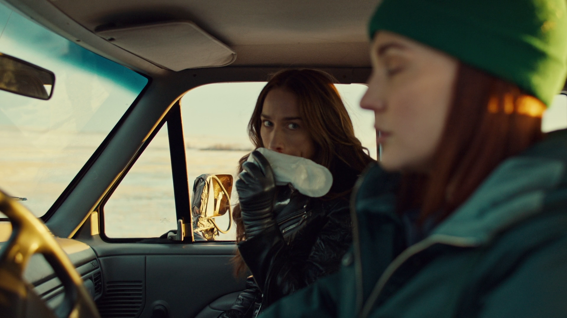 Wynonna, using a pad to stop her bloody after a well deserved punch from Nicole.