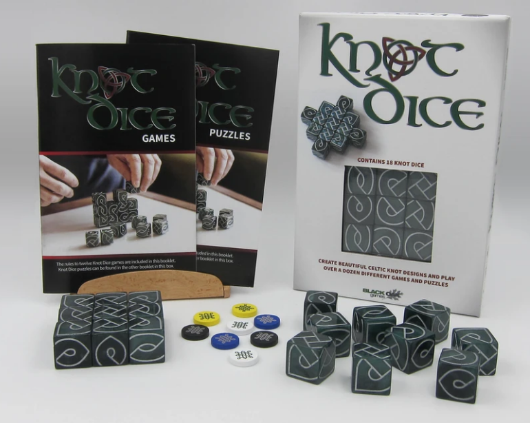 knot dice packaging with 18 dice, 8 wooden tokens, and games and puzzles booklets