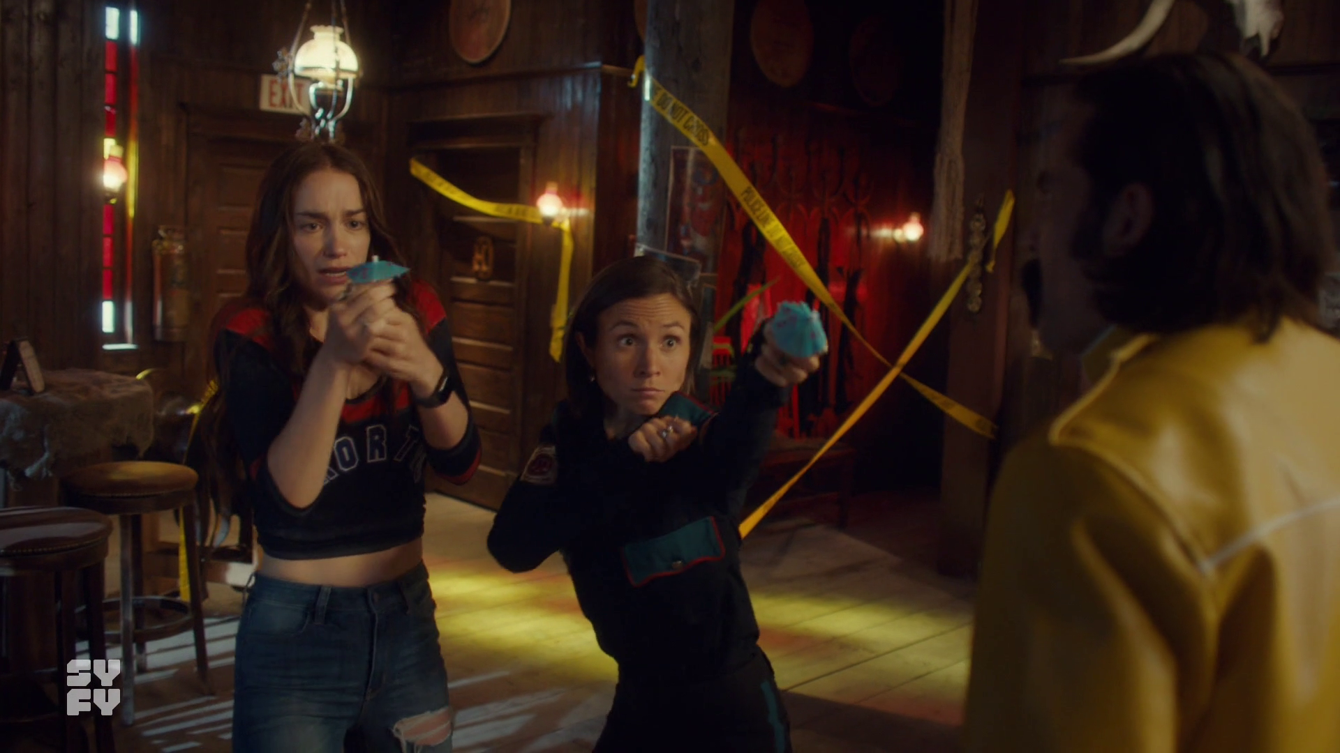 Wynonna and Waverly defending themselves with little paper umbrellas