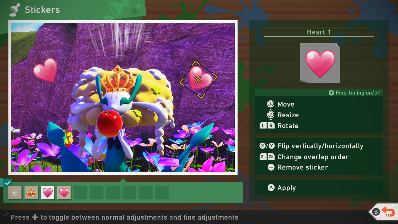 A screenshot of the game's photo editing system, demonstrating how players can layer stickers on top of the photos they take.  The given picture shows a flower pokemon surrounded by heart stickers.