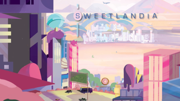 sweetlandia box cover with title in blue and above pastel buildings and lake