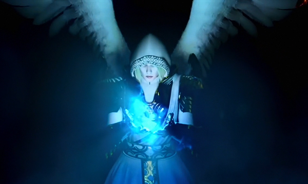 An in-game render of a woman with angel wings and magical blue energy in her hands.