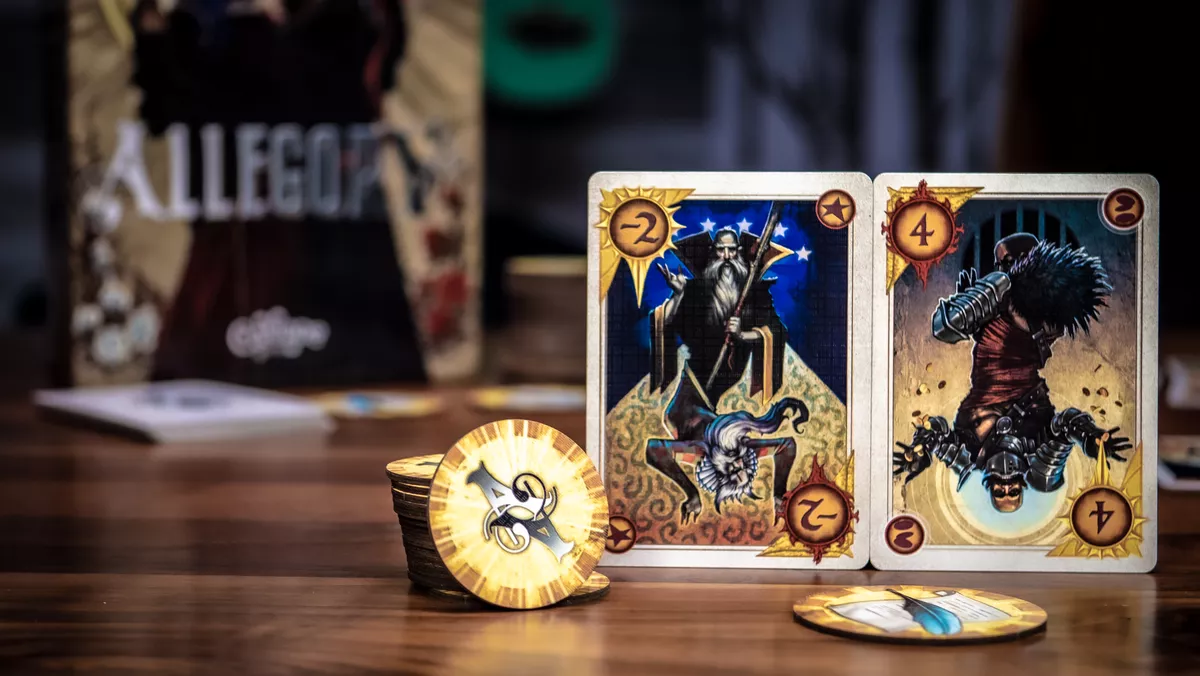 Components for Allegory including betting chips, cards, and the box in the background